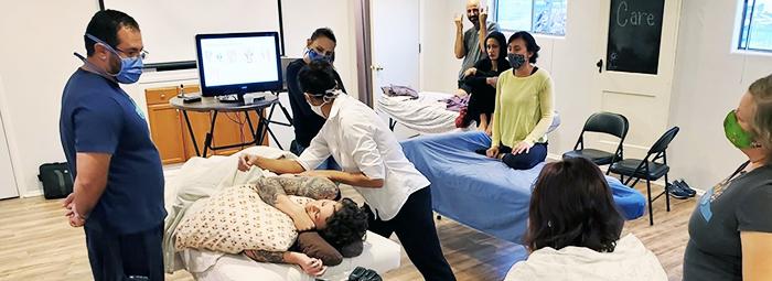 adrienne teaching massage technique image